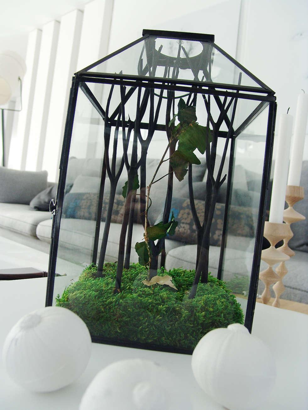 Salas de estilo ecléctico por Adventive