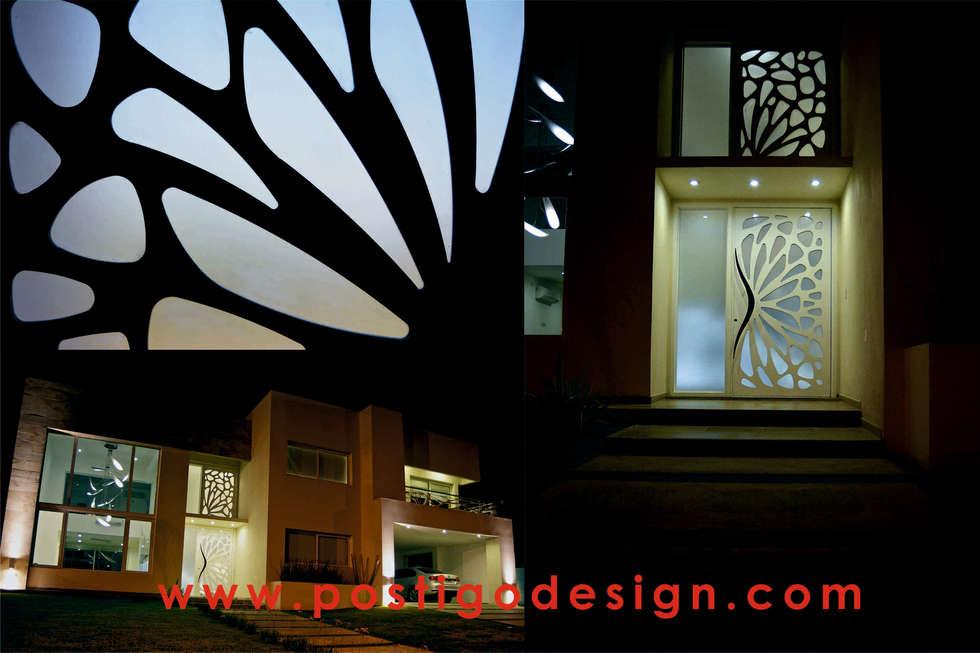 Puerta Filo: Casas de estilo moderno por Postigo design