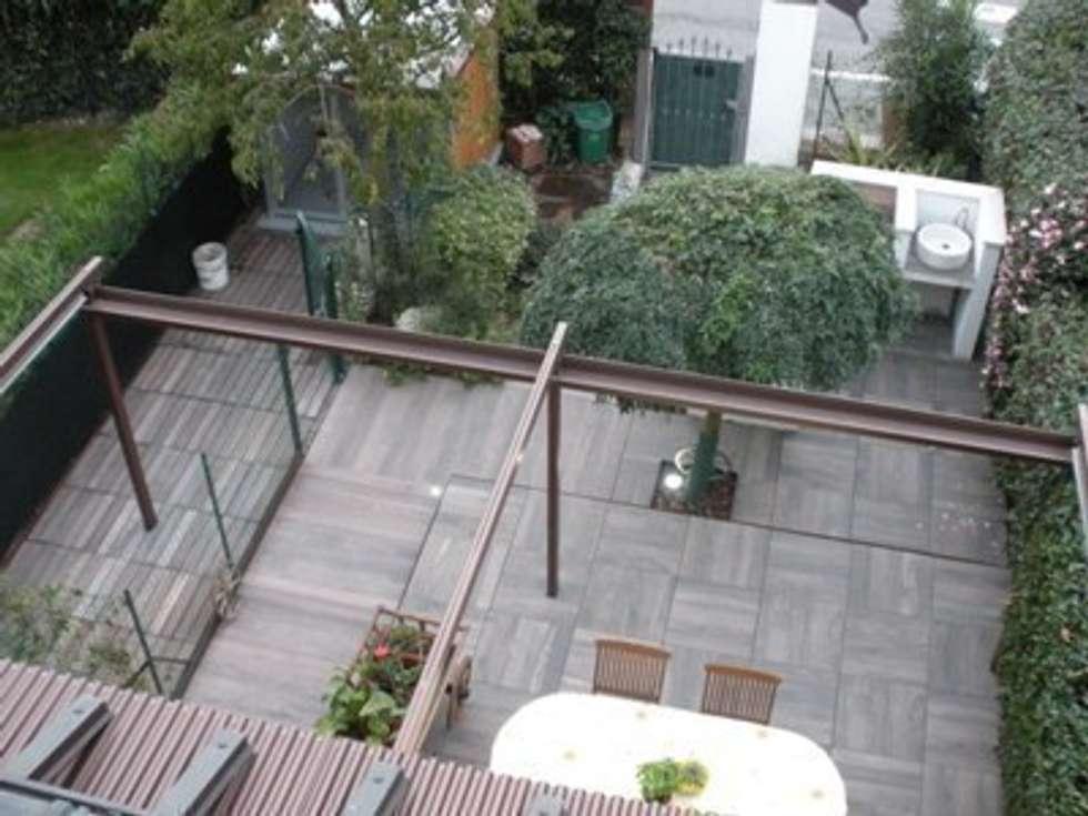 Unico colore, formati diversi: Giardino in stile in stile Moderno di Arch.Susanna Tamborini lapaesaggista.it