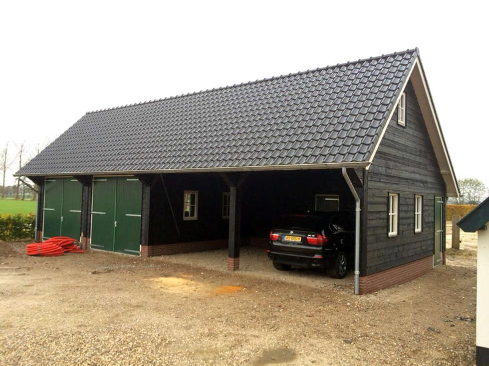 Foto s van een landelijke garage schuur houten garages homify - Keuken steen en hout ...