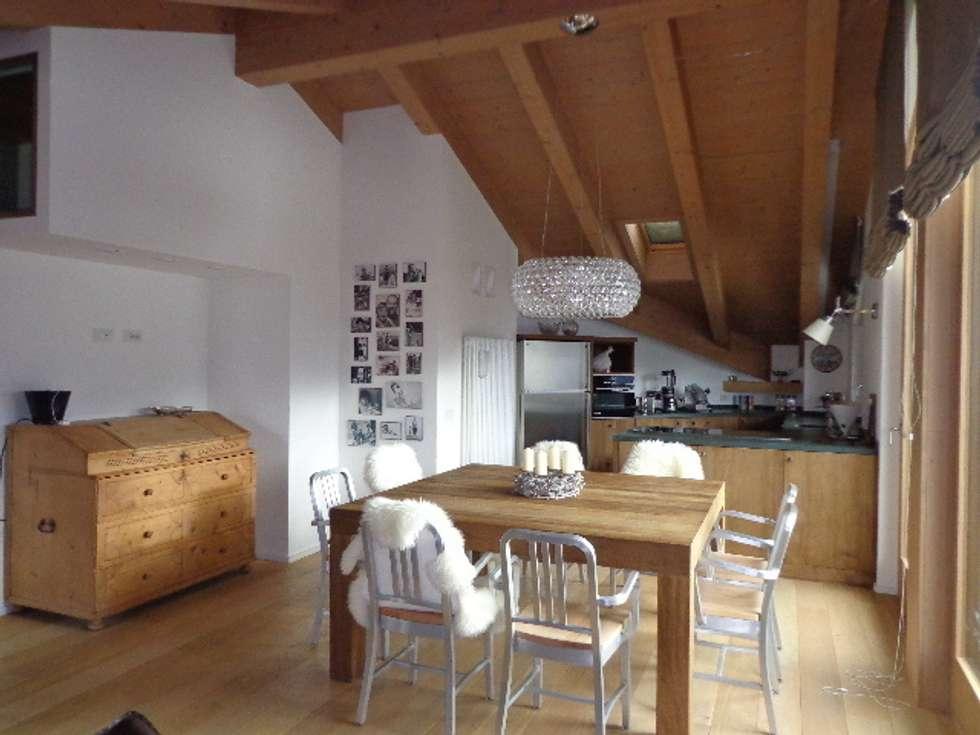 Tavolo in rovere massello: Sala da pranzo in stile in stile Moderno di Architetto Stefania Colturi
