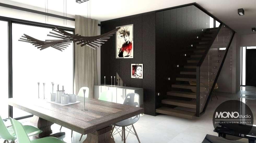 Nowoczesny dom o bardzo ciekawej formie, którego wnętrza korespondują z zewnętrzem.: styl , w kategorii Jadalnia zaprojektowany przez MONOstudio