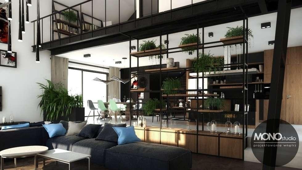 Nowoczesny dom o bardzo ciekawej formie, którego wnętrza korespondują z zewnętrzem.: styl , w kategorii Salon zaprojektowany przez MONOstudio