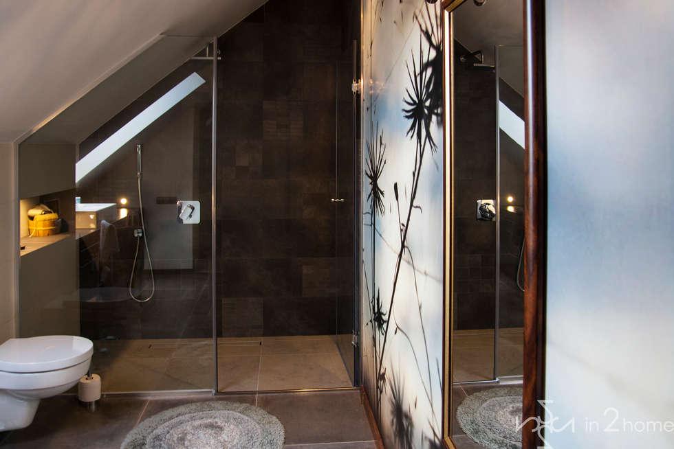 Baños de estilo  por in2home