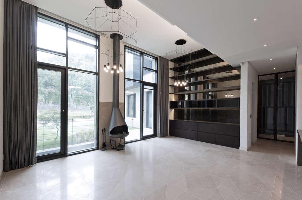 Casa 911: Design Tomorrow INC.의  거실