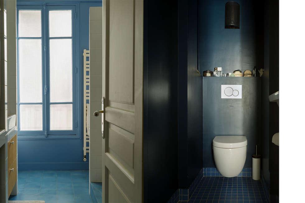 Pièces d'eau: Salle de bains de style  par claire Tassinari