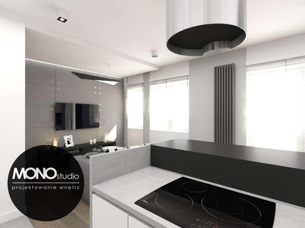 Wyjątkowo przytulna i ciepła aranżacja apartamentu w Krakowie: styl , w kategorii Kuchnia zaprojektowany przez MONOstudio