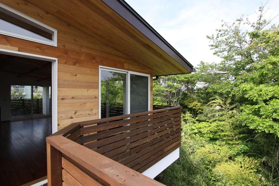 Casas de estilo escandinavo por アトリエグローカル一級建築士事務所