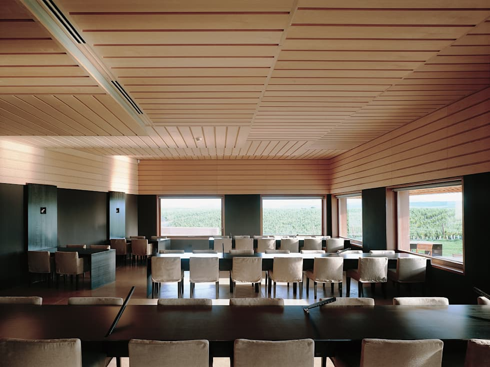Sala da pranzo in stile in stile Minimalista di Ignacio Quemada Arquitectos