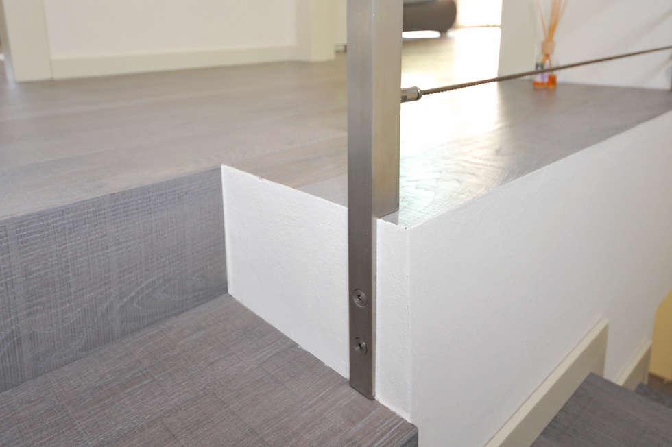 esempio di finitura bordo scala: Pareti in stile  di EMMEDUE di Ferruccio Mattiello