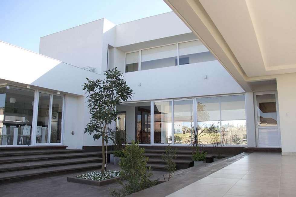 El corazón de la vivienda: Casas de estilo moderno por CB Design