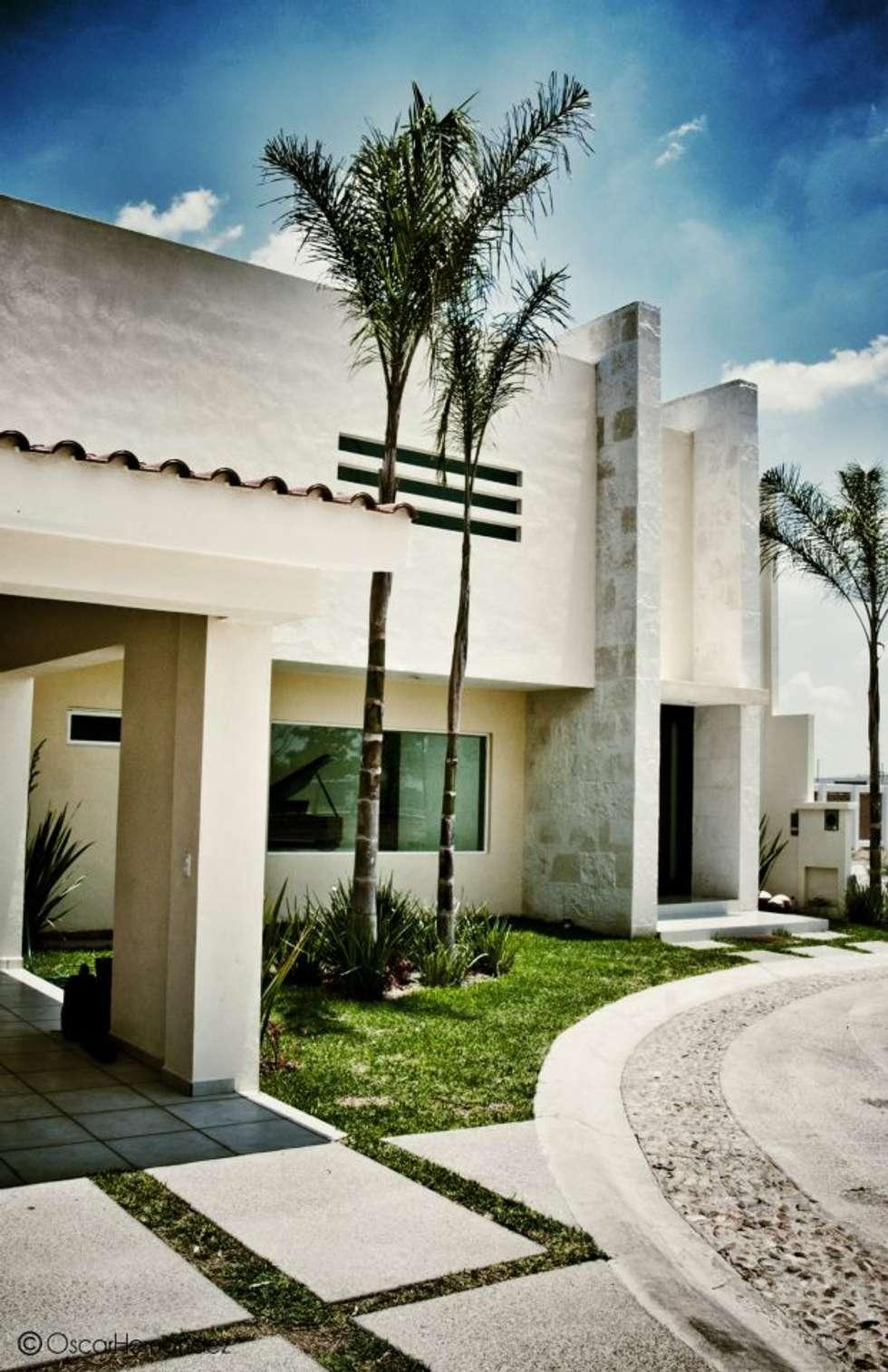 Casa Habitación - Lager: Casas de estilo moderno por MATE - ARQUITECTOS