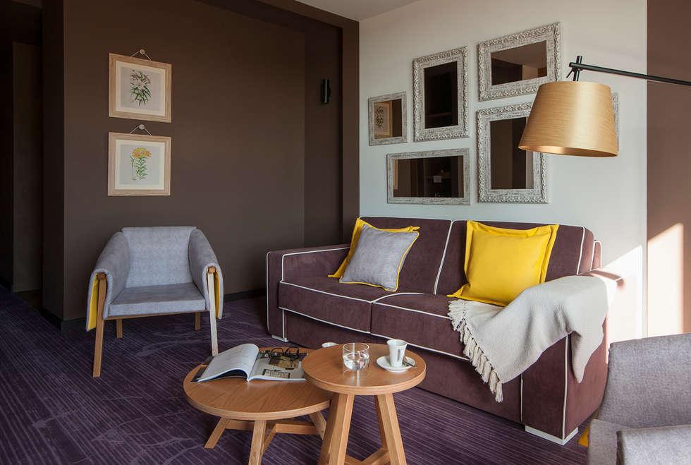 Temática da suite alusiva ao lírio : Hotéis  por Tralhão Design Center