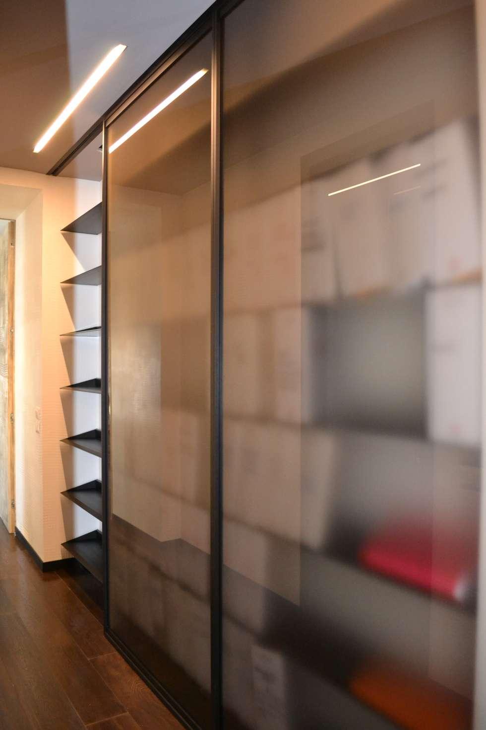 disimpegno: Studio in stile in stile Moderno di bilune studio