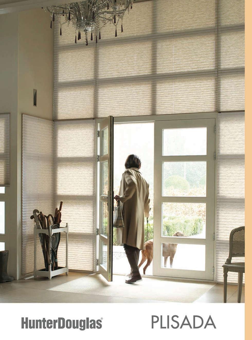 Plisada: Salas de estilo minimalista por Dekorier Interiores