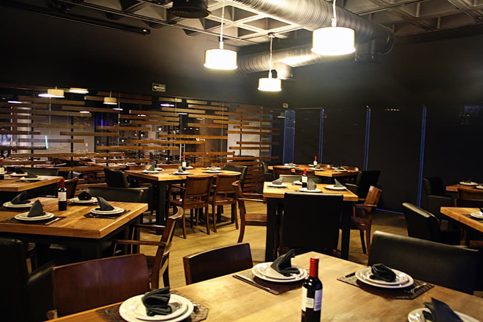 Area de fumadores: Restaurantes de estilo  por Narda Davila arquitectura