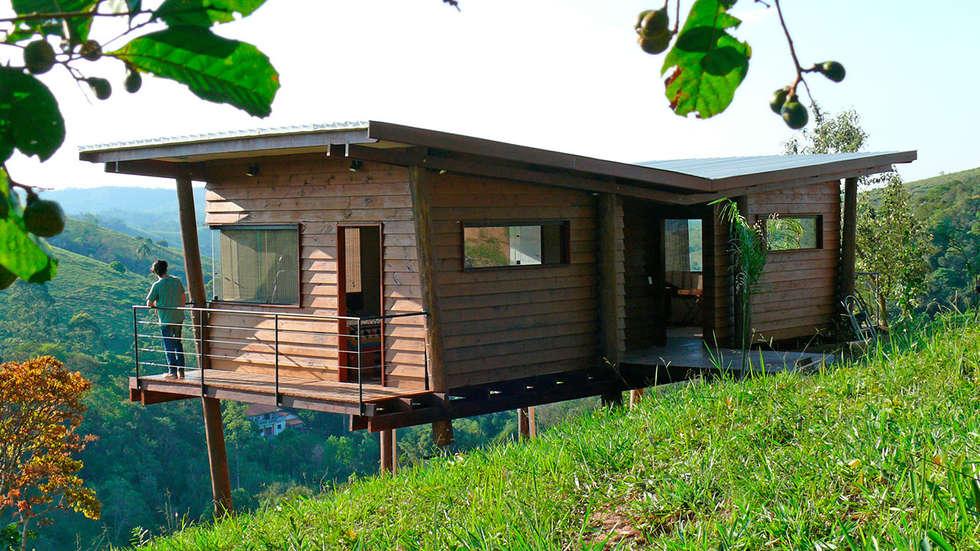 Casa em Guararema: Casas rústicas por Cabana Arquitetos