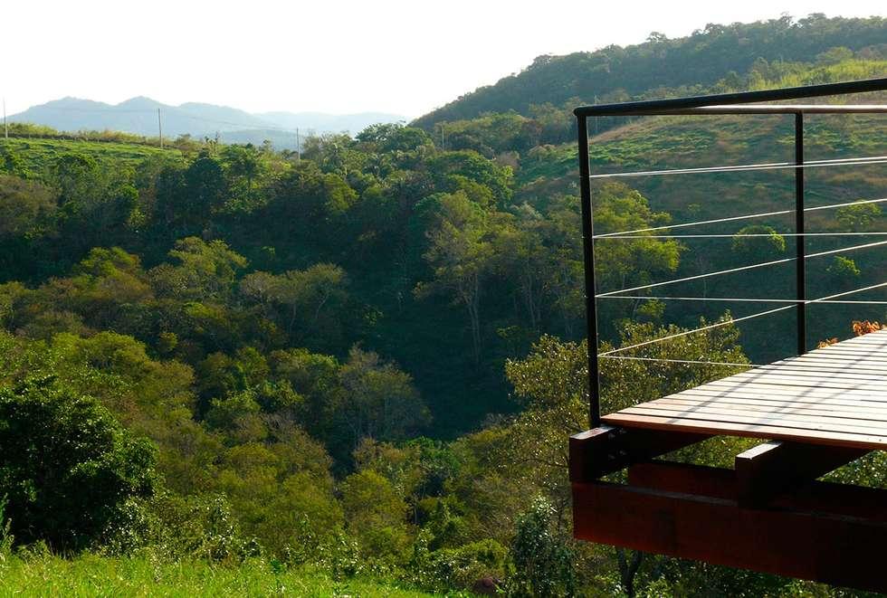 Vista da varanda: Terraços  por Cabana Arquitetos