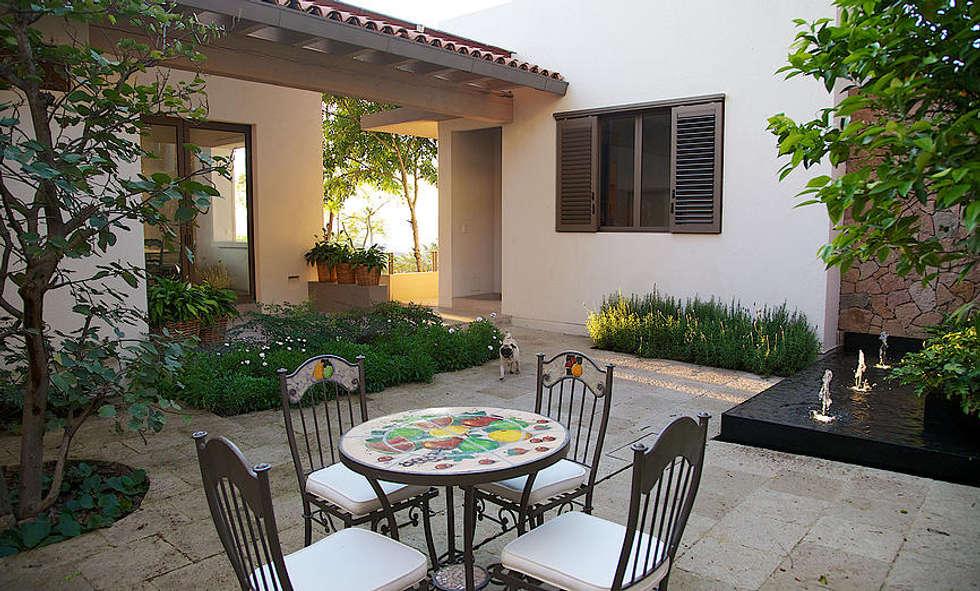 Jardin de style de style eclectique par A Mayúscula Arquitectos