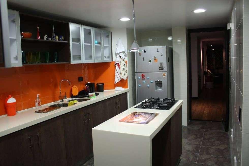Apartamento Daniel Anzola: Cocinas de estilo moderno por Heritage Design Group