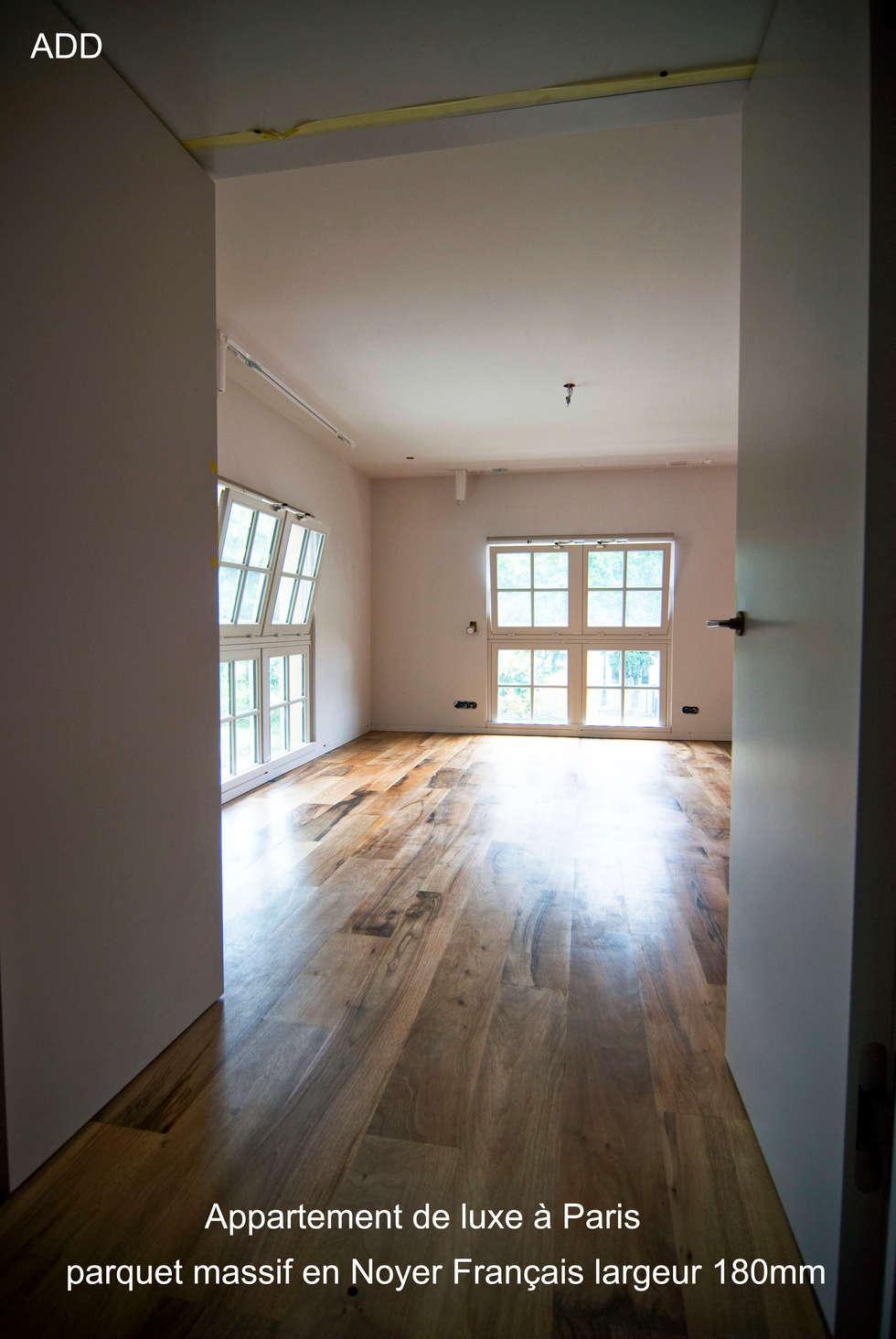 Appartement réhabilité , fourniture des parquets en noyer Français ADD  20X180X1800mm: Salon de style de style Moderne par ADD