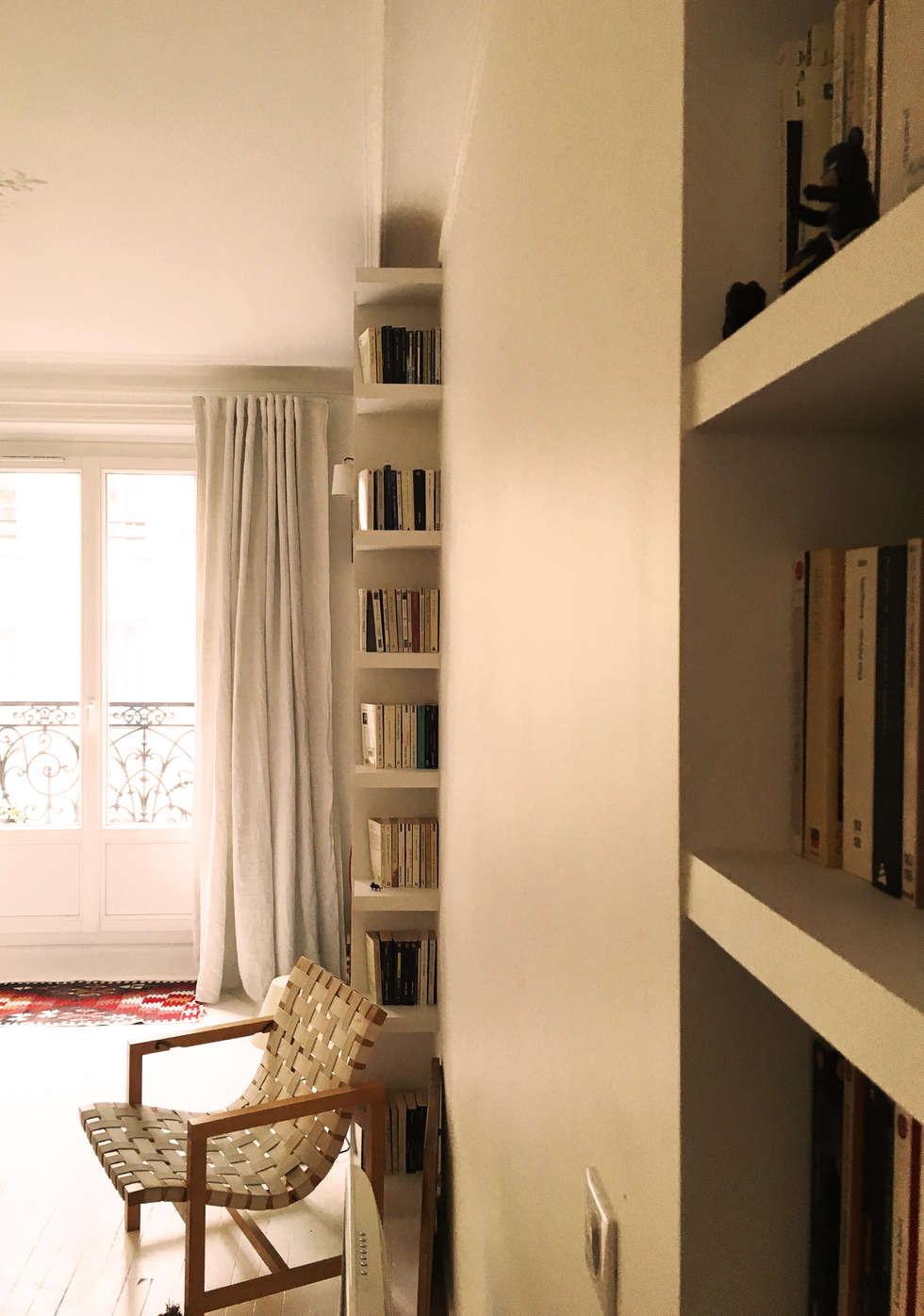 bibliothèques sur mesures: Salon de style de style Scandinave par Agence KP