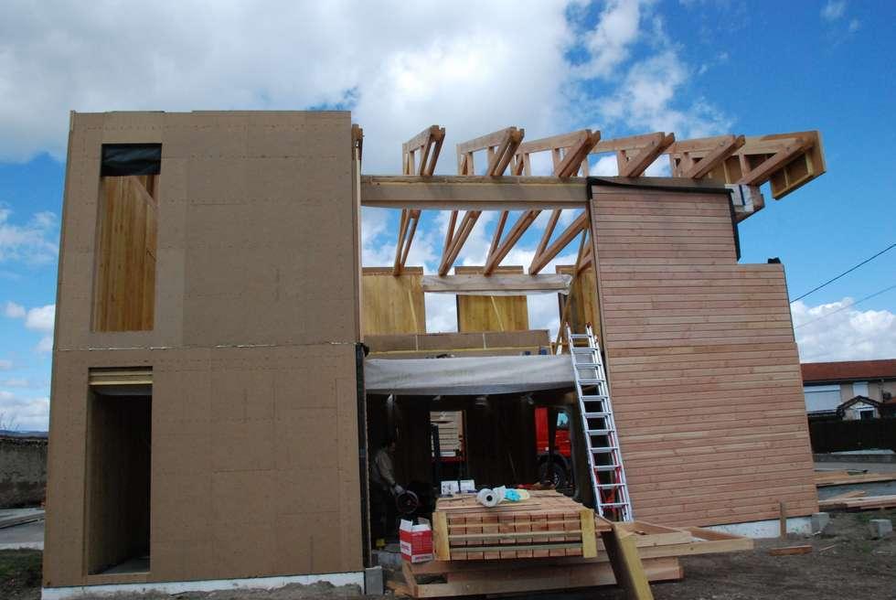 Le chantier: Maisons de style de style Moderne par archipente