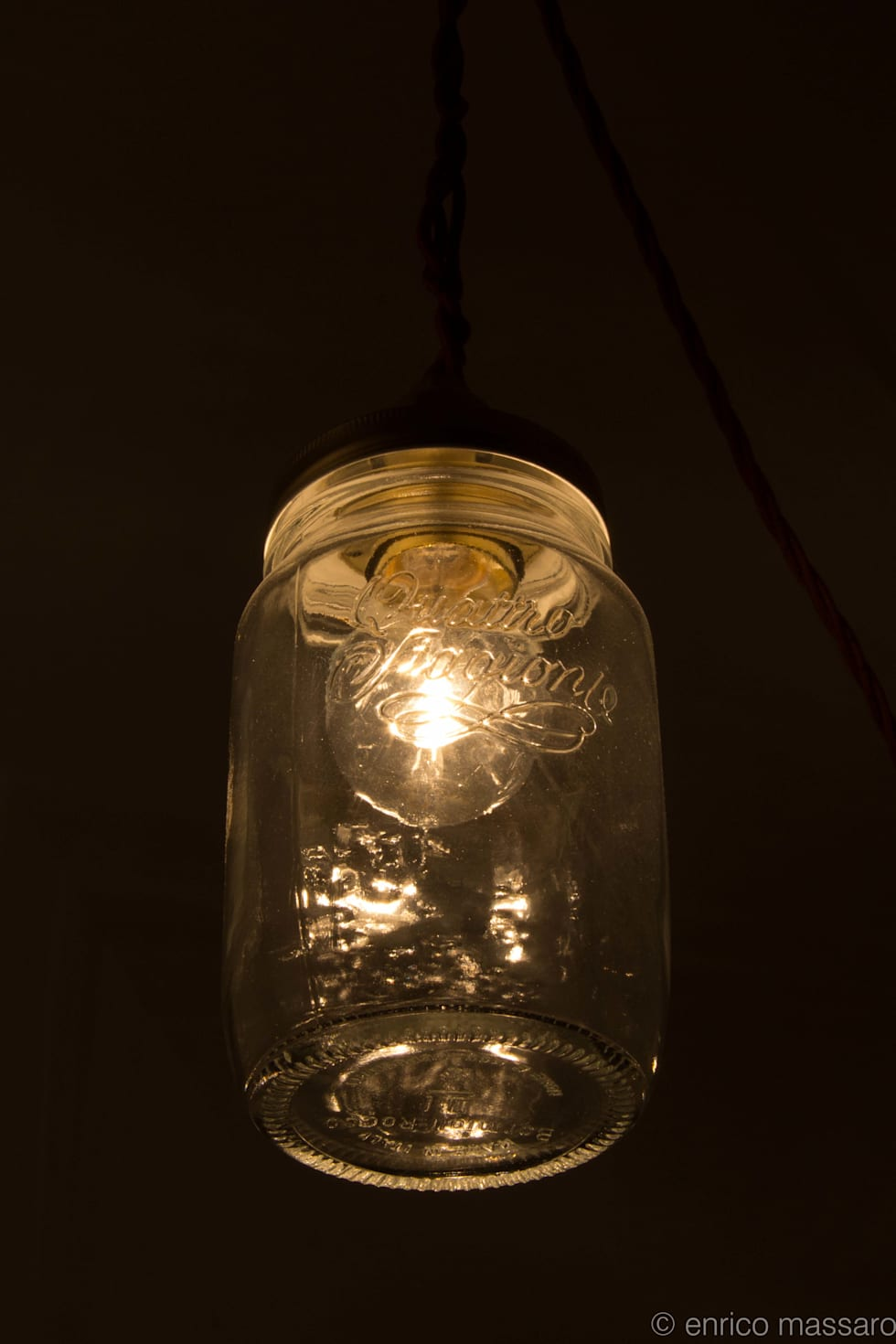 """illuminare con """"gusto"""": Ingresso & Corridoio in stile  di enrico massaro architetto"""