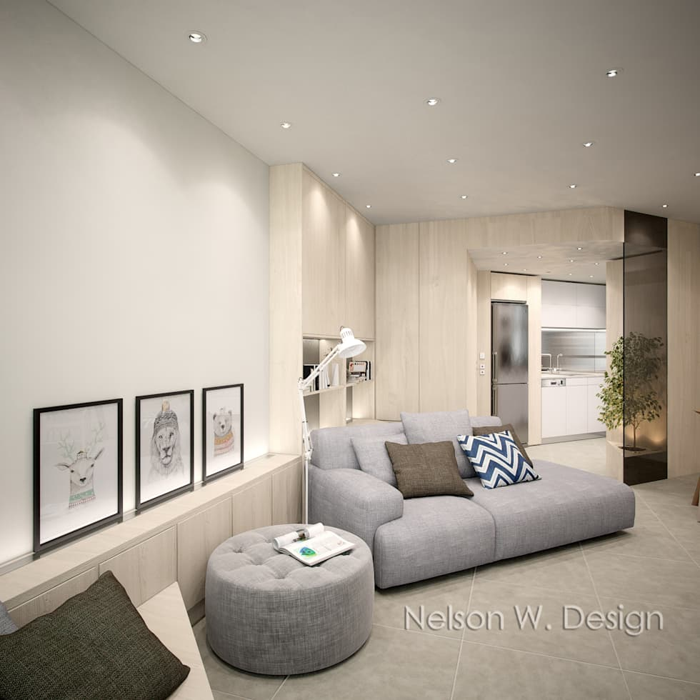 Concealed front door create tidy and open living space: modern Living room by Nelson W Design