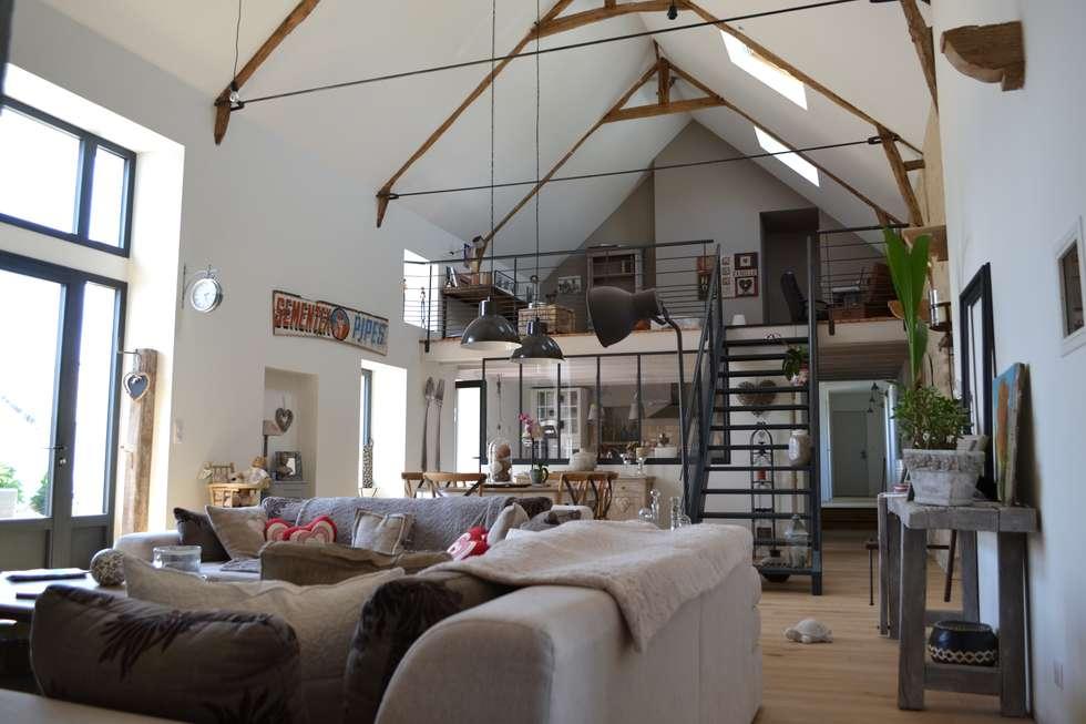Livings de estilo industrial por Courants Libres