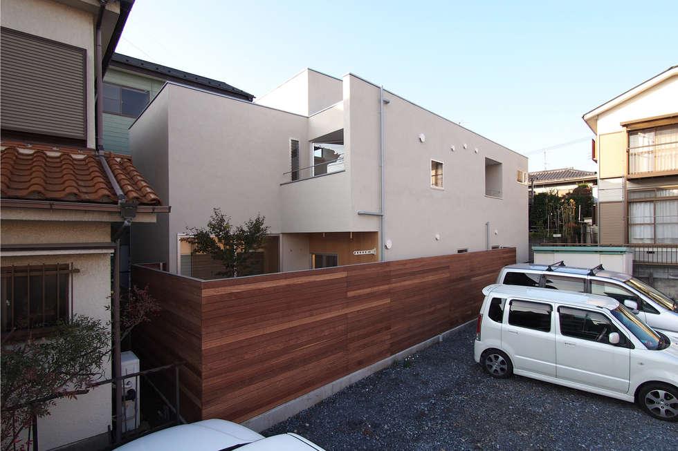 Casas de estilo minimalista por アトリエ スピノザ