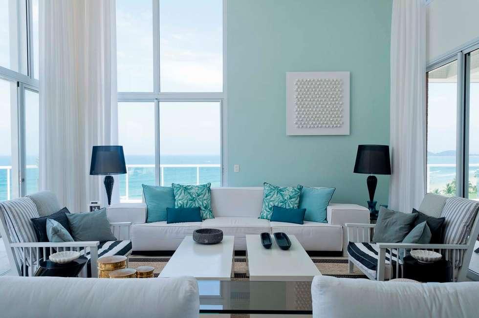 Cobertura Riviera: Salas de estar modernas por Toninho Noronha Arquitetura