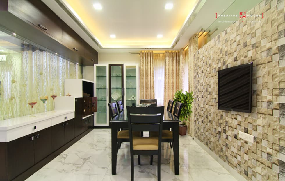 A TRIPLEX VILLA NEAR SUNCITY, HYDERABAD: modern Dining room by KREATIVE HOUSE