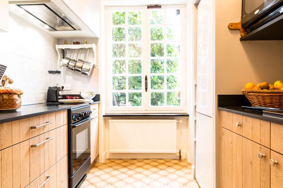 cuisine évolution en chêne massif: Cuisine de style de style Classique par MJ Home