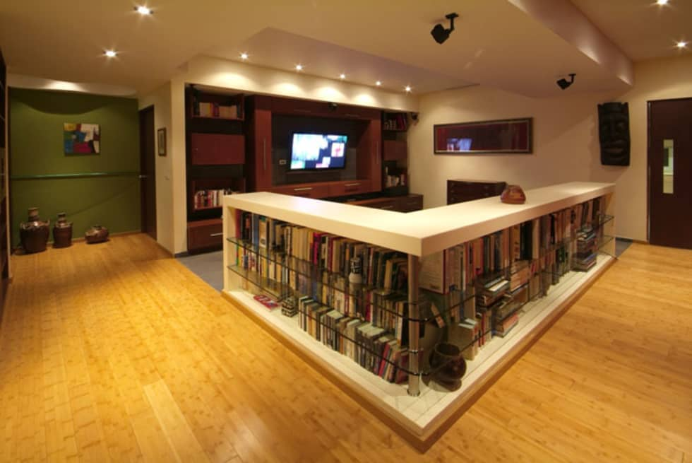 Departamento Chelu : Salas multimedia de estilo moderno por DIN Interiorismo