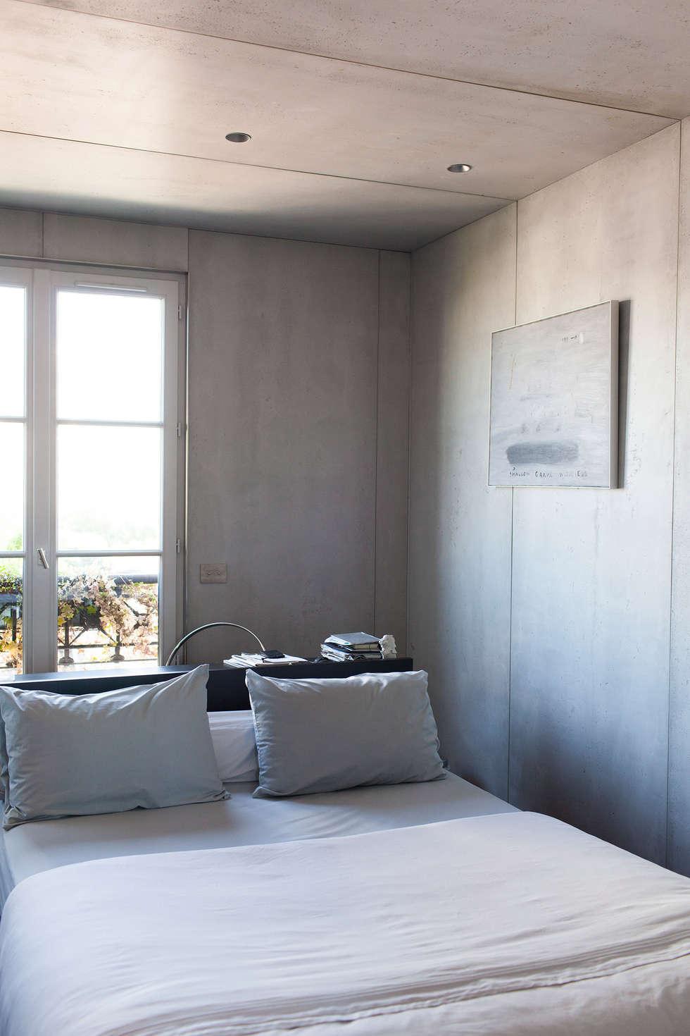 Concrete Flat: Chambre de style de style Moderne par Concrete LCDA