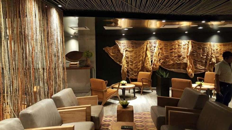 Salas - Lobby: Hoteles de estilo  por CHIMI