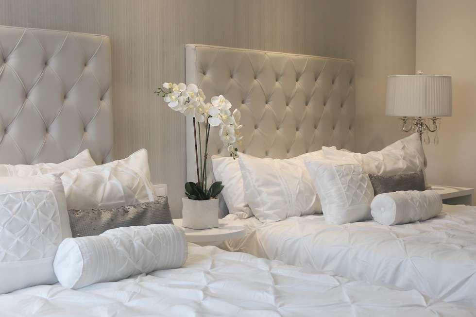 Habitación doble: Habitaciones de estilo moderno por Monica Saravia