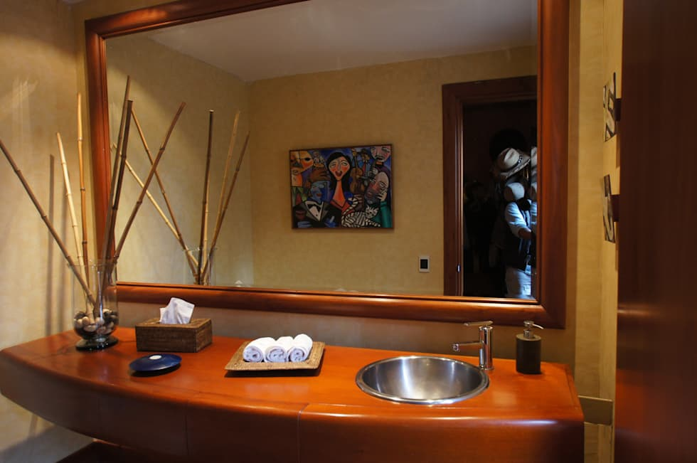 Vivienda Sandquist: Baños de estilo ecléctico por GRUPO CATA