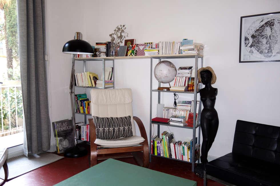 Une bibliothèque confortable: Salon de style de style eclectique par Sarah Archi In'