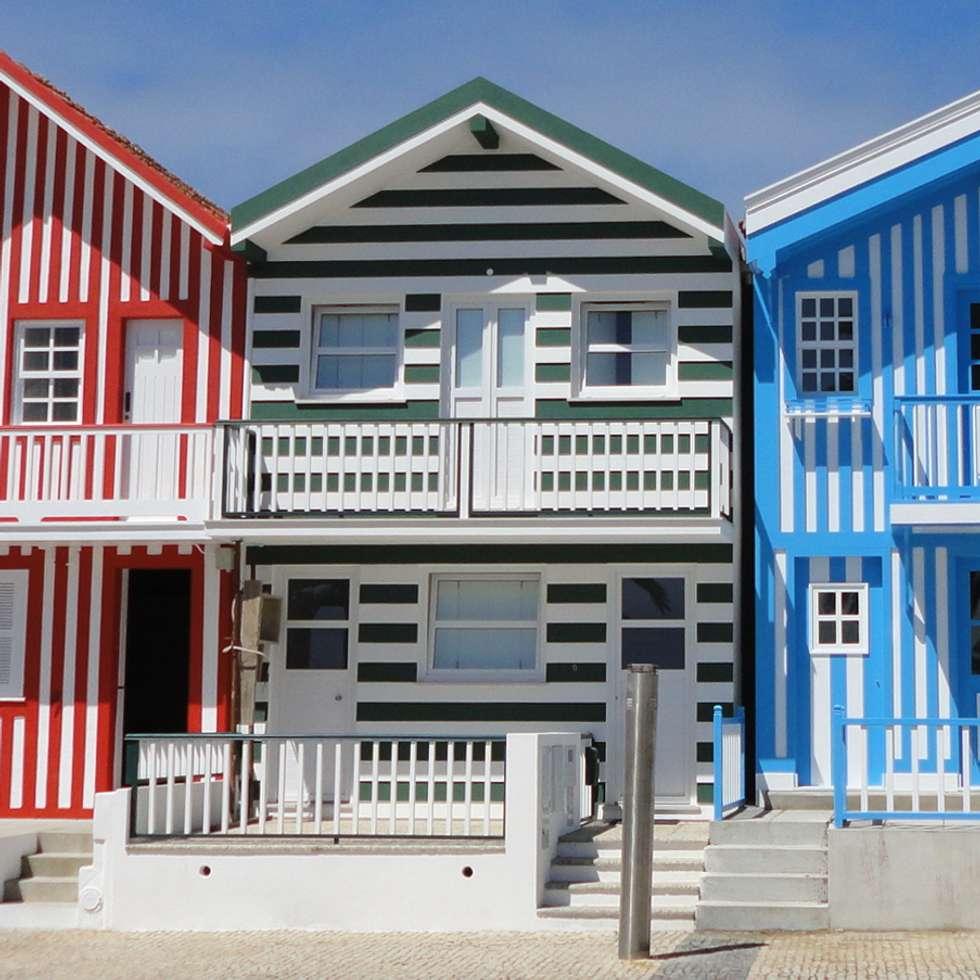 Alçado principal: Casas ecléticas por GAAPE - ARQUITECTURA, PLANEAMENTO E ENGENHARIA, LDA