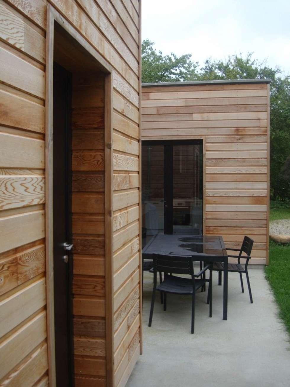 terrasse / accès cuisine: Maisons de style de style Moderne par Olivier Olindo Architecte