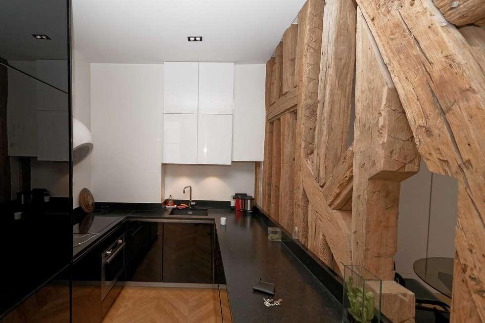 Rénovation d'une cuisine Paris 2ème: Cuisine de style de style Moderne par Plombier Paris Express