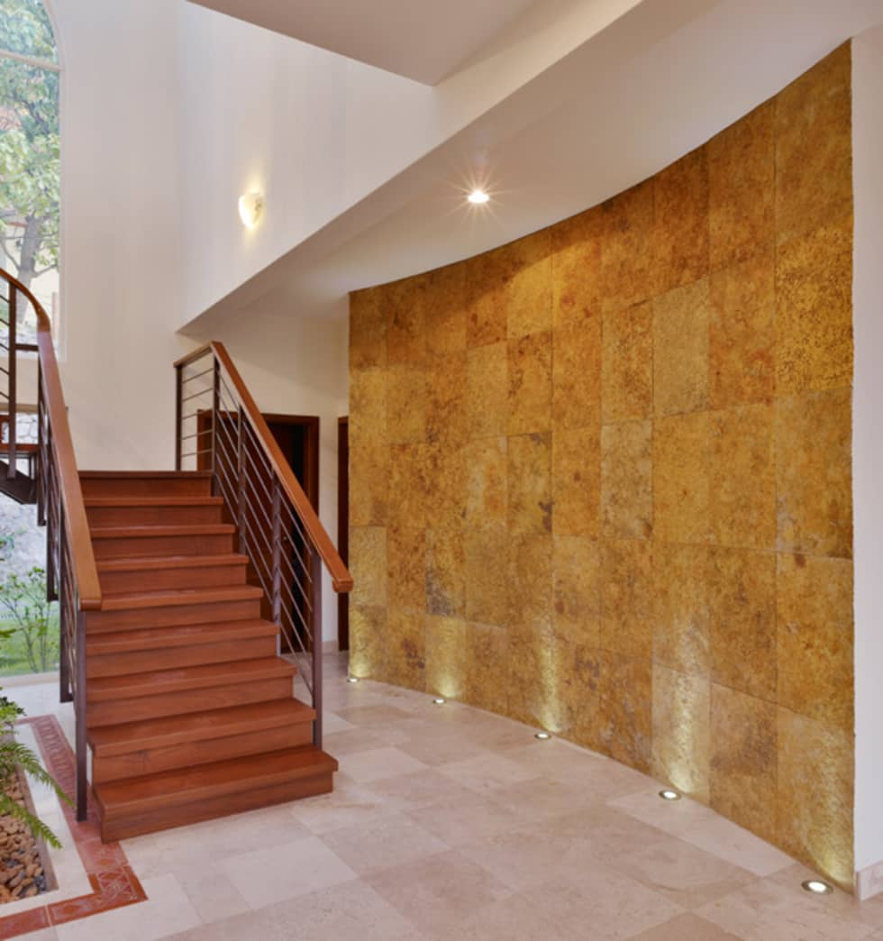 muro central: Paredes de estilo  por Excelencia en Diseño