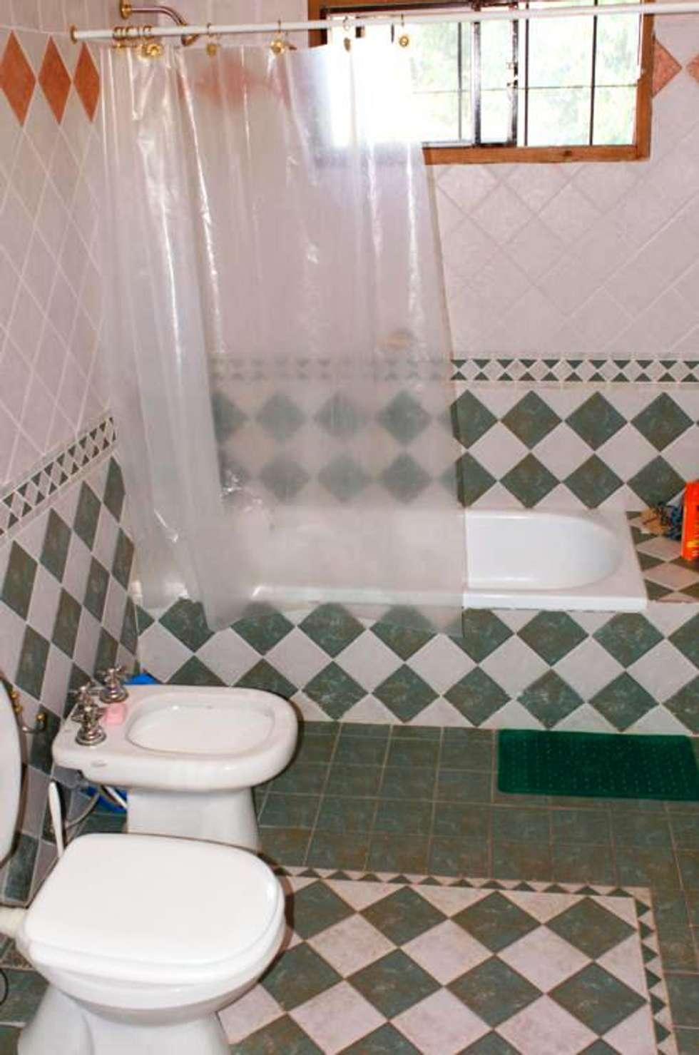baño: Baños de estilo rústico por Liliana almada Propiedades
