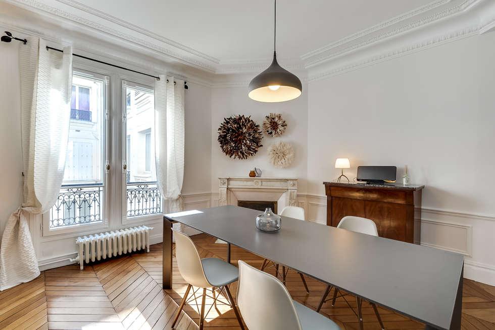 Salle à manger design aux lignes classiques: Salle à manger de style de style Moderne par Decorexpat