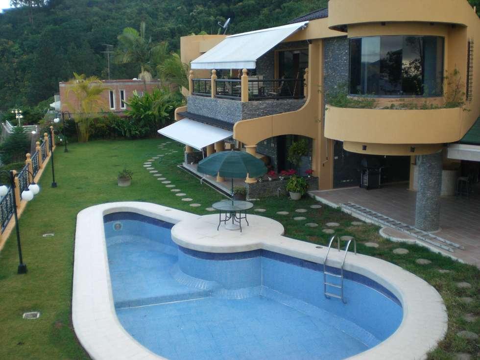 Diseño exclusivo de vivienda lujosa: Casas de estilo moderno por INVERSIONES NACSE S.A.S.