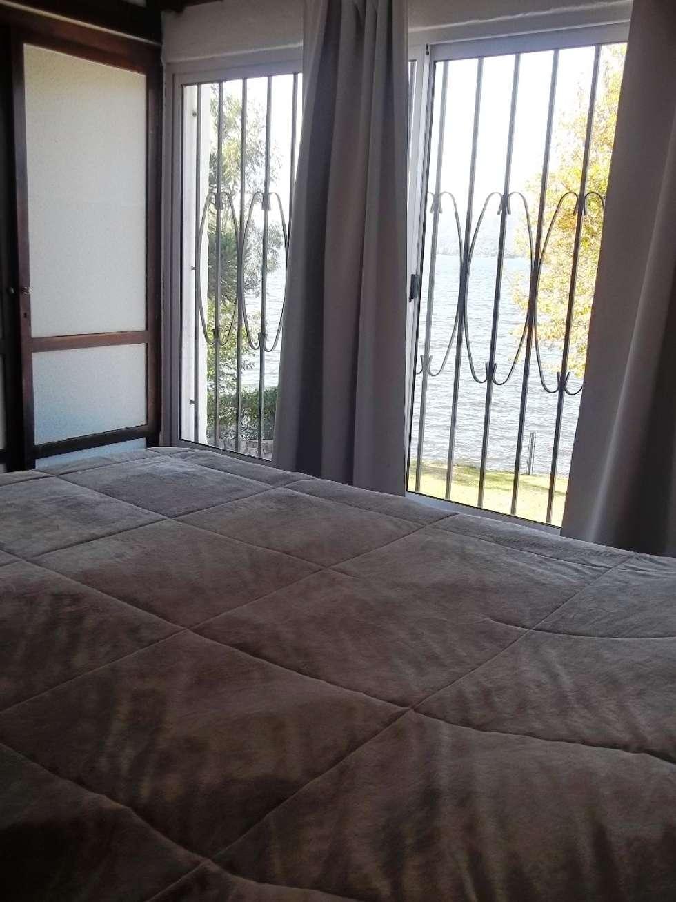 Habitación: Dormitorios de estilo clásico por Liliana almada Propiedades