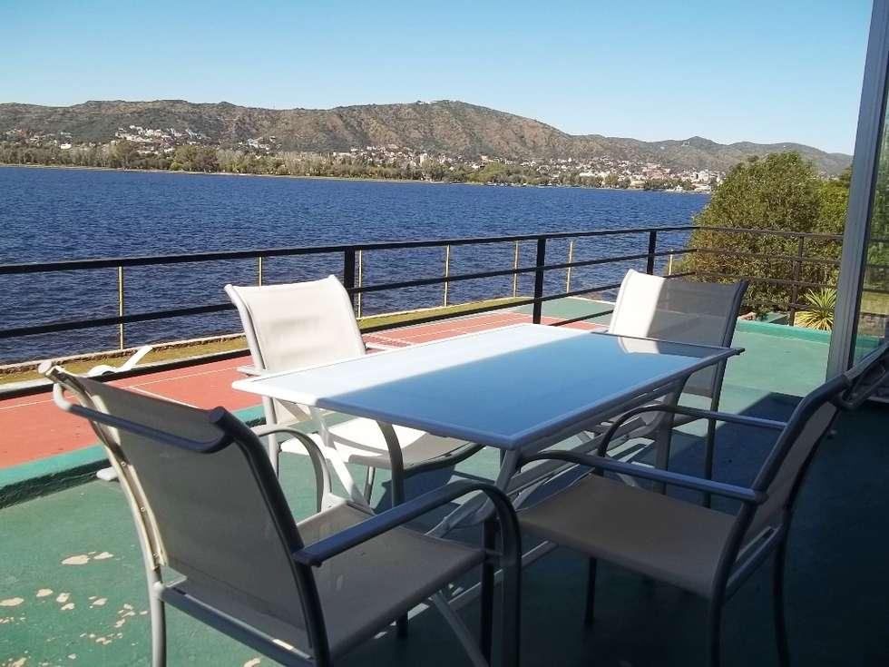 Balcón: Terrazas de estilo  por Liliana almada Propiedades