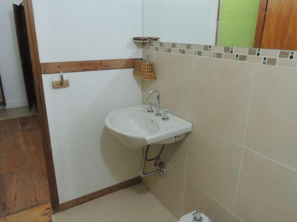lavatorio: Baños de estilo moderno por CRISTINA FORNO